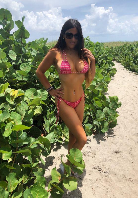 Claudia Romani in a red Bikini at Delray Beach