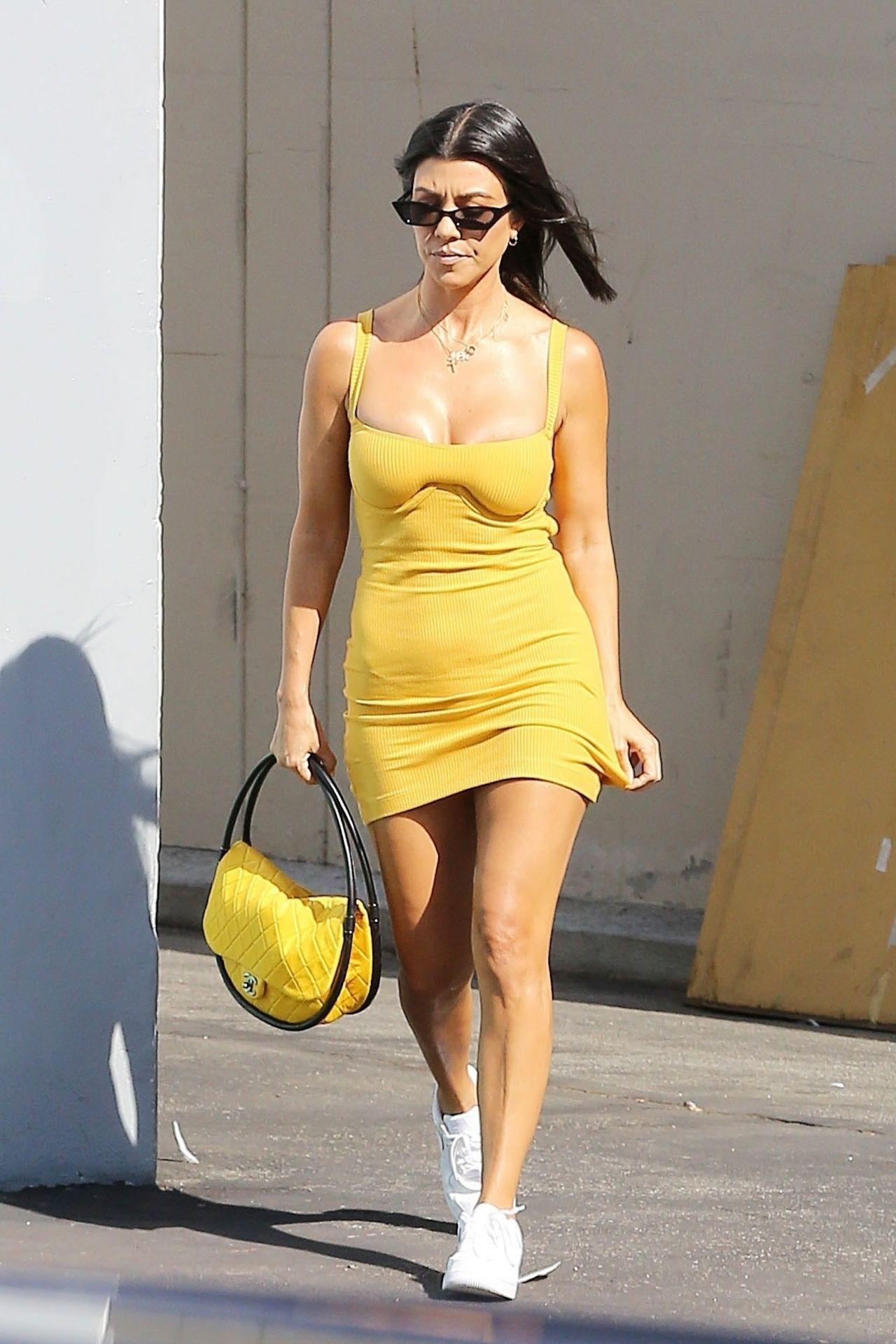kourtney kardashian in a yellow mini dress los angeles