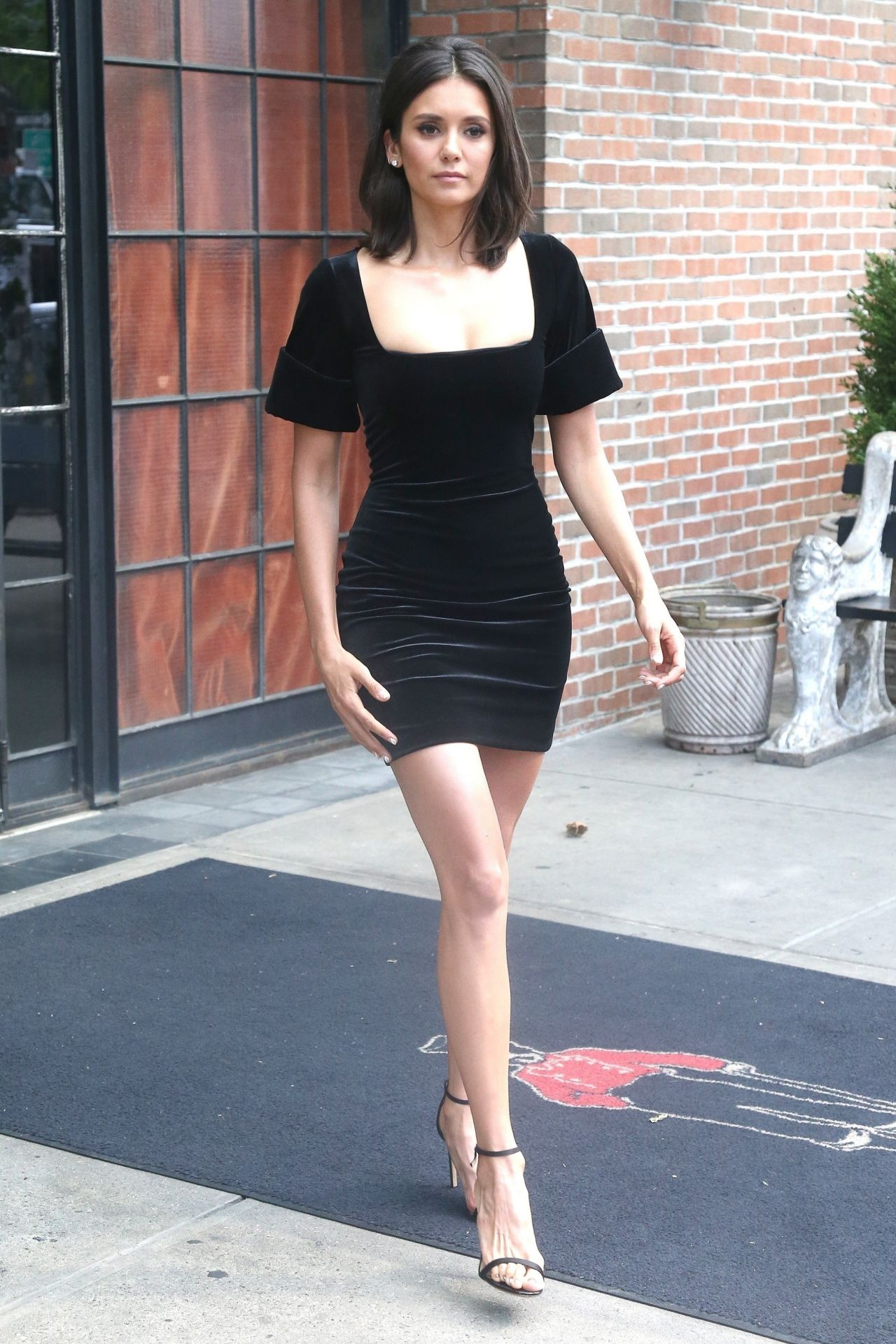 https://celebmafia.com/wp-content/uploads/2018/08/nina-dobrev-in-a-black-dress-leaving-her-hotel-in-nyc-08-08-2018-9.jpg