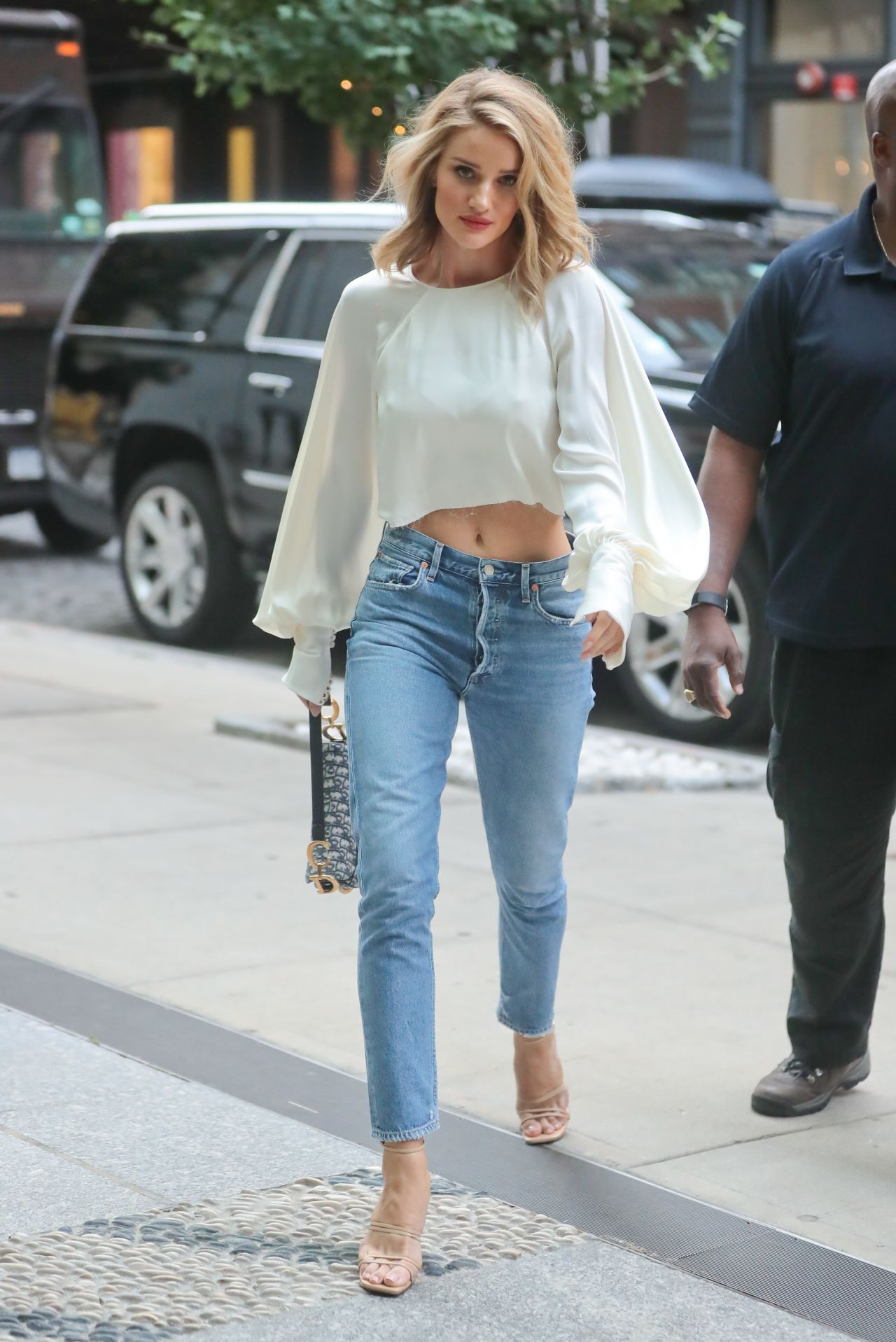 Rosie Huntington-Whiteley in a White Top and Jeans in New ...