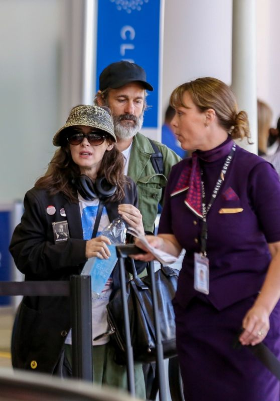 Winona Ryder and Scott Mackinlay Hahn at LAX in LA 09/21/2018
