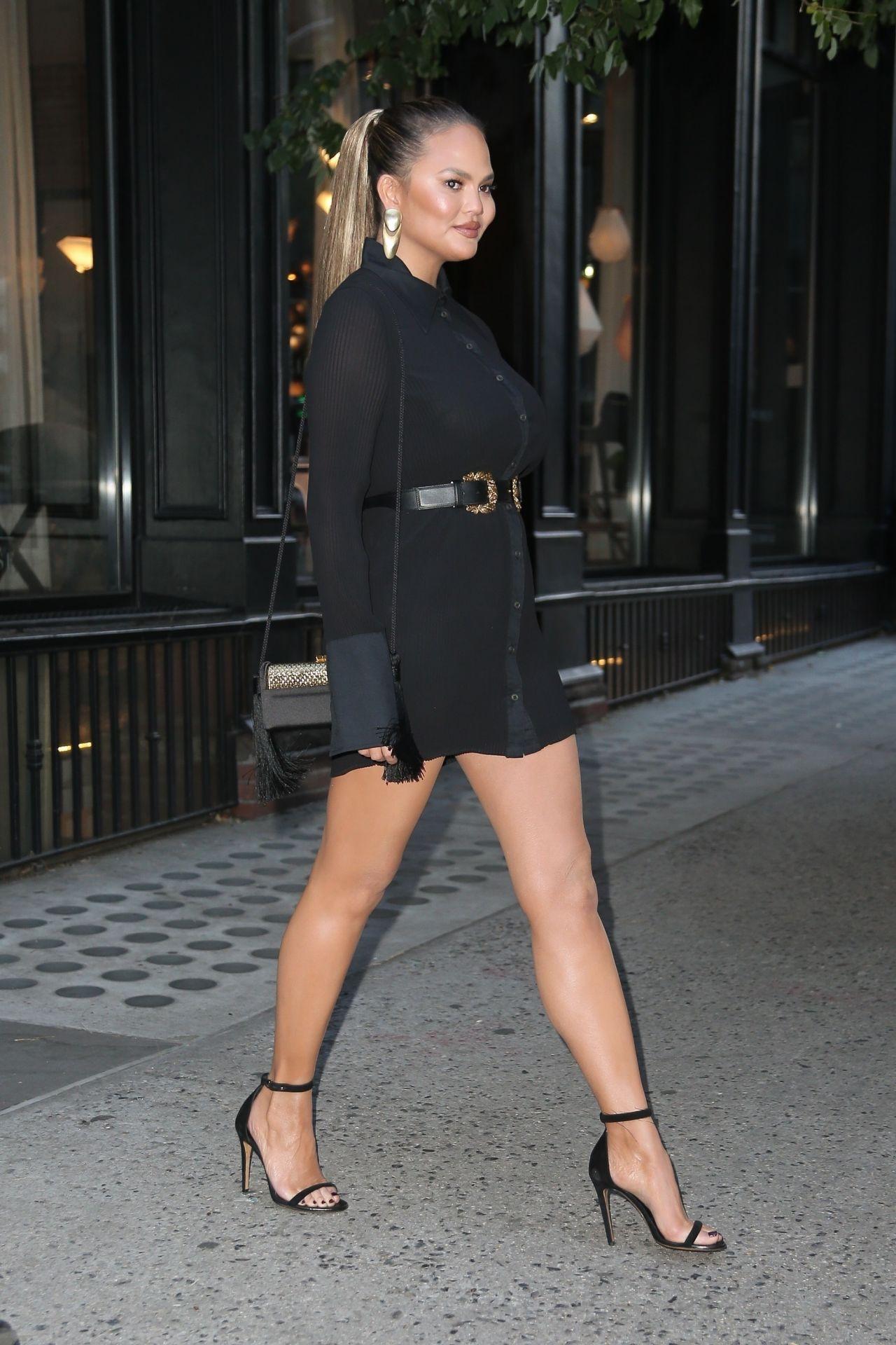 Chrissy Teigen In A Short Black Dress And Heels In New