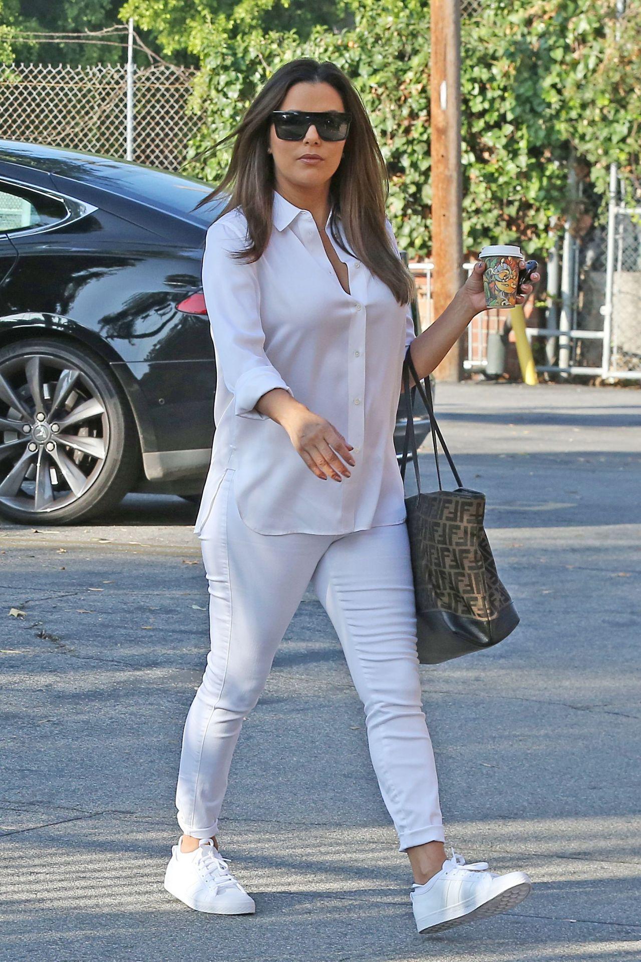 https://celebmafia.com/wp-content/uploads/2018/10/eva-longoria-in-a-stylish-all-white-outfit-out-in-la-10-24-2018-5.jpg