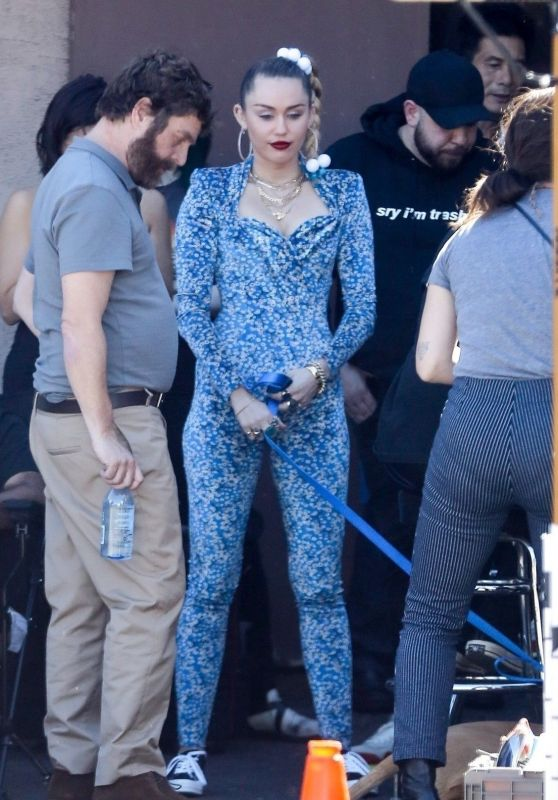 Miley Cyrus in a Blue Floral Jumpsuit On Set of Her Latest Project in LA 10/18/2018