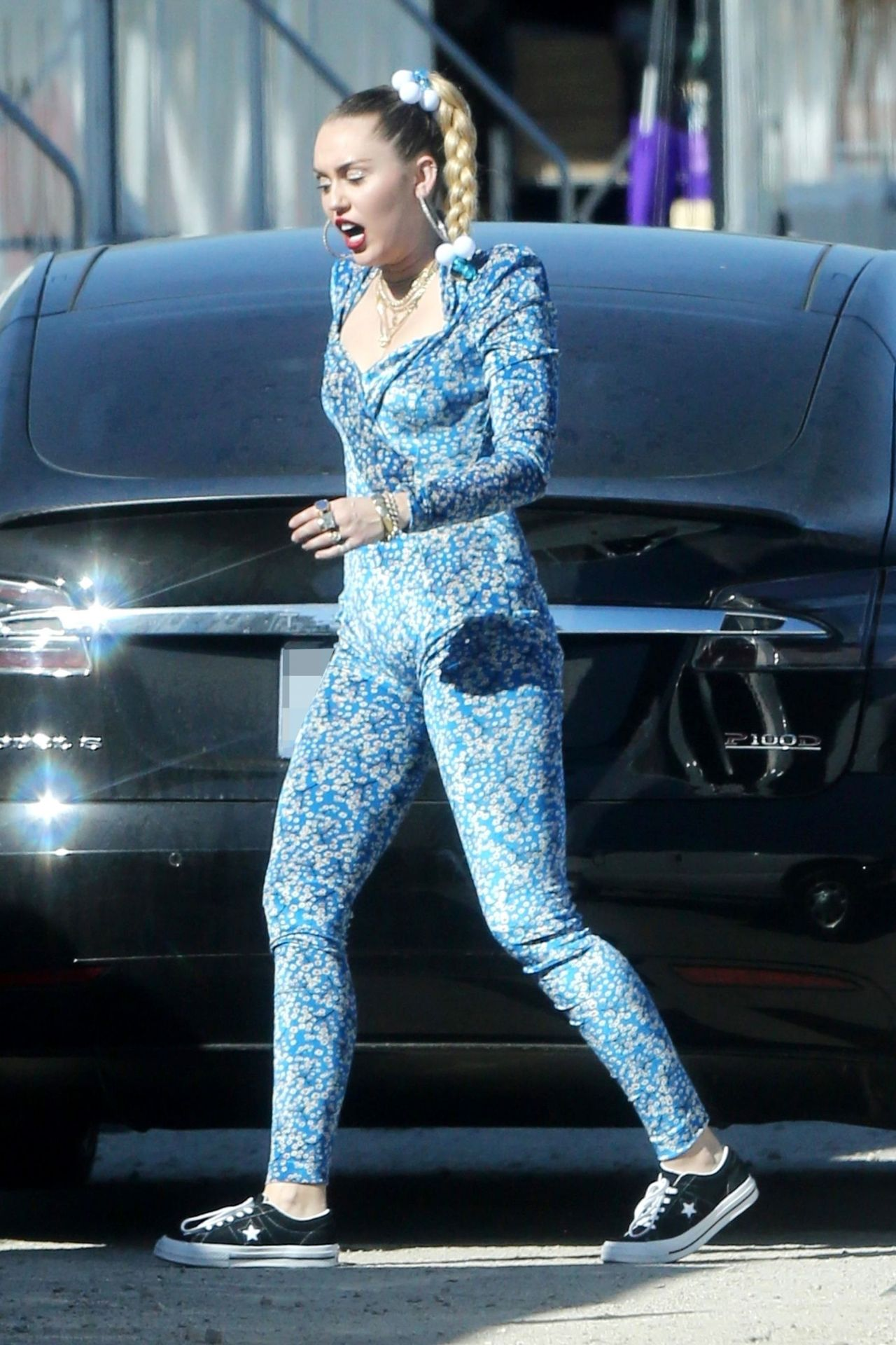 Miley Cyrus In A Blue Floral Jumpsuit On Set Of Her Latest