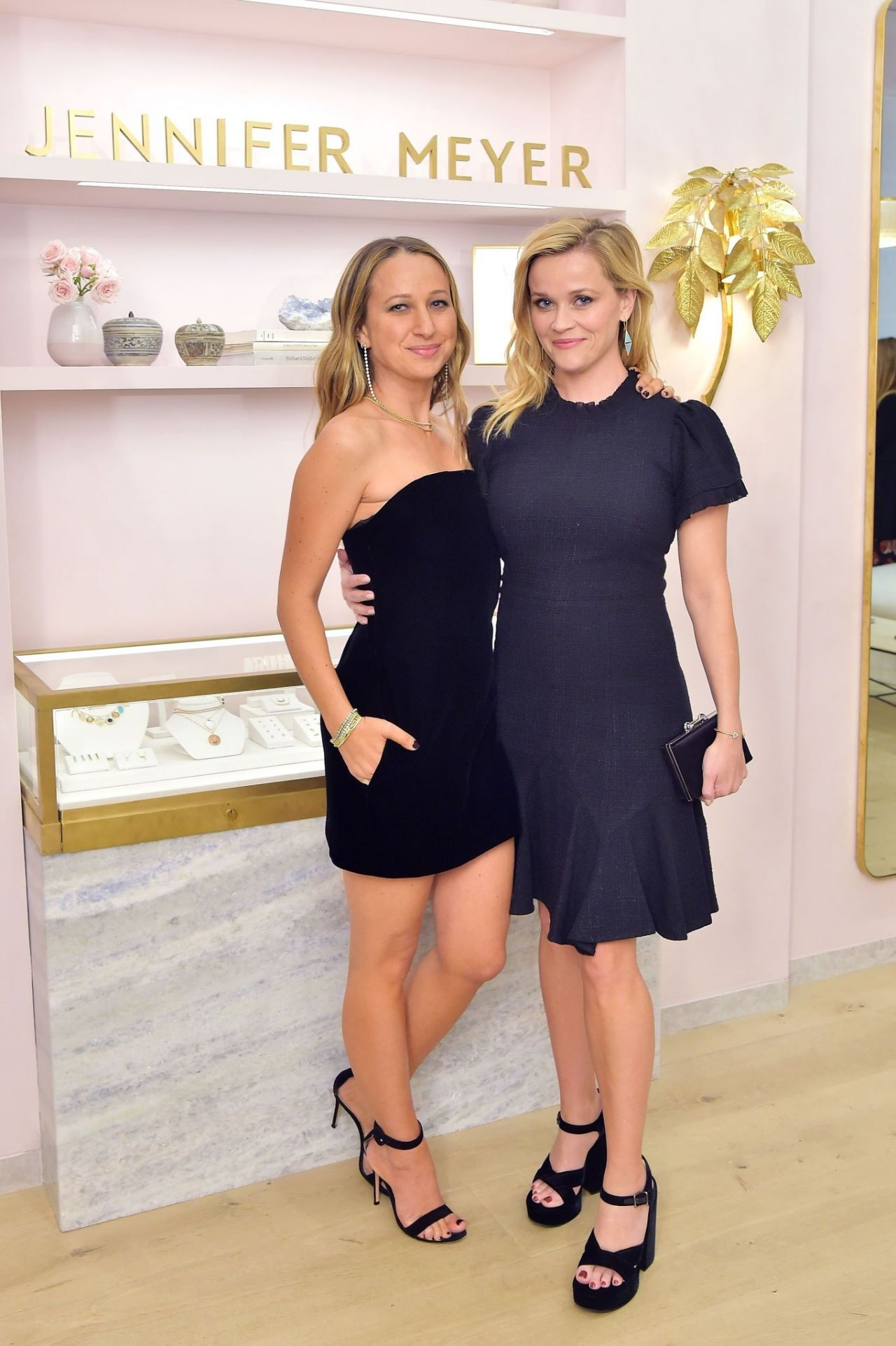 https://celebmafia.com/wp-content/uploads/2018/10/reese-witherspoon-jennifer-meyer-celebrates-first-store-opening-in-palisades-village-10-17-2018-0.jpg