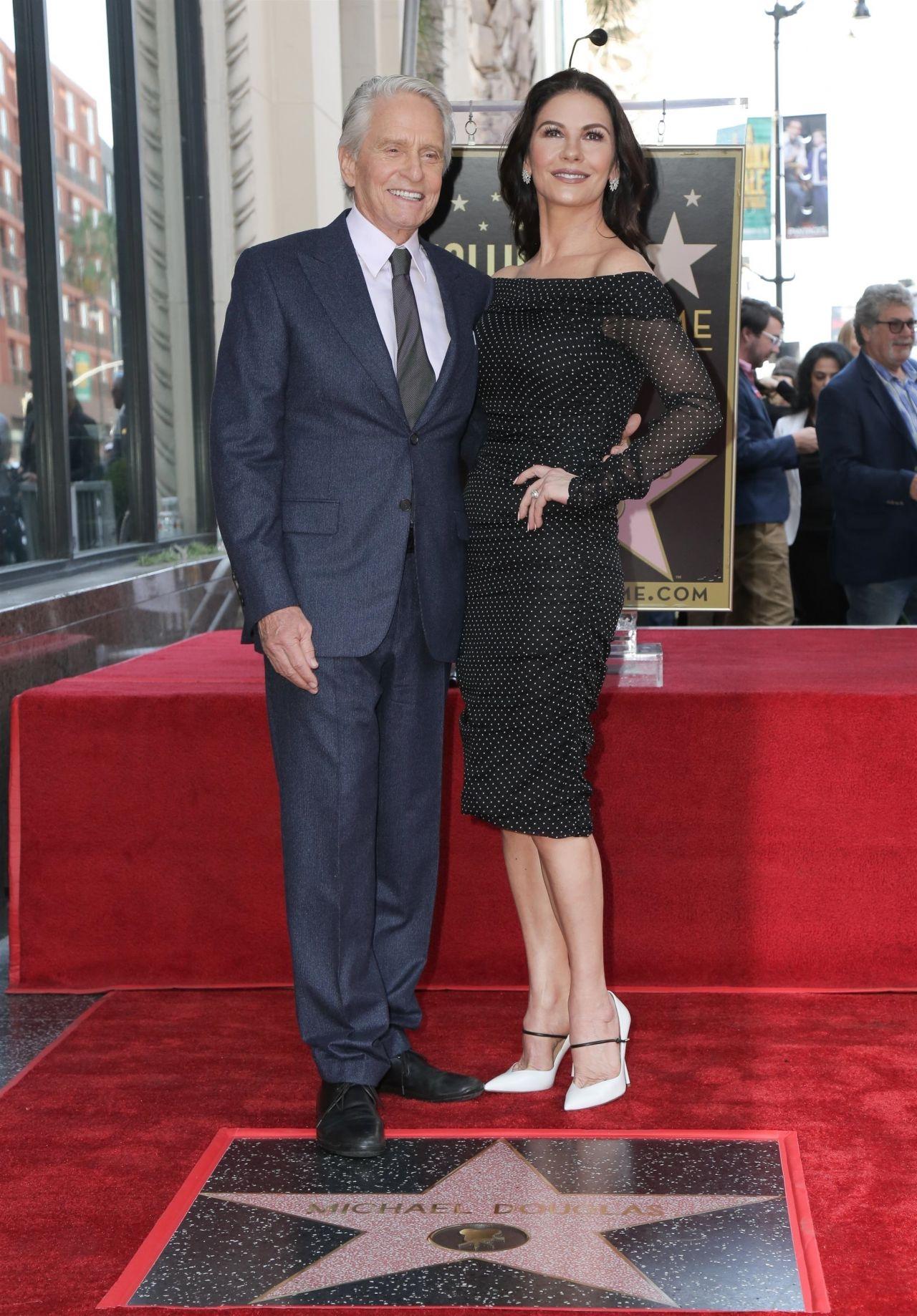 https://celebmafia.com/wp-content/uploads/2018/11/catherine-zeta-jones-michael-douglas-honored-with-a-star-on-the-hollywood-walk-of-fame-11-06-2018-9.jpg