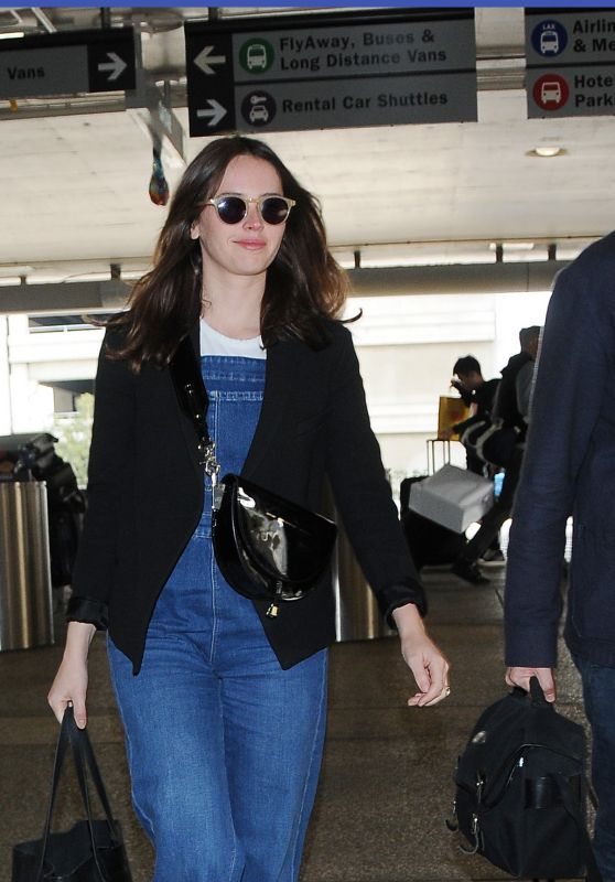 Felicity Jones With Her Husband Charles Guard at LAX Airport 11/19/2018