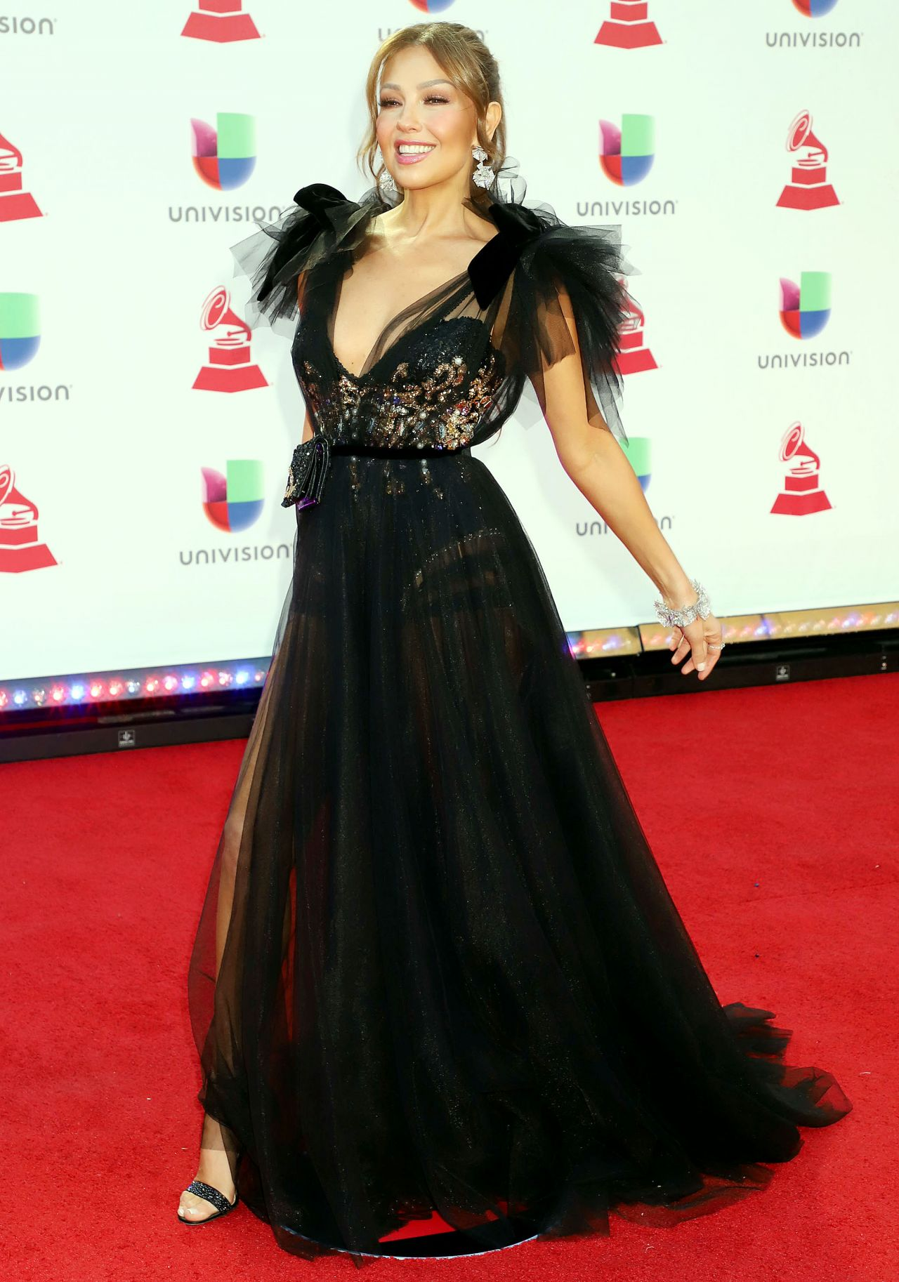 https://celebmafia.com/wp-content/uploads/2018/11/thalia-2018-latin-grammy-awards-1.jpg