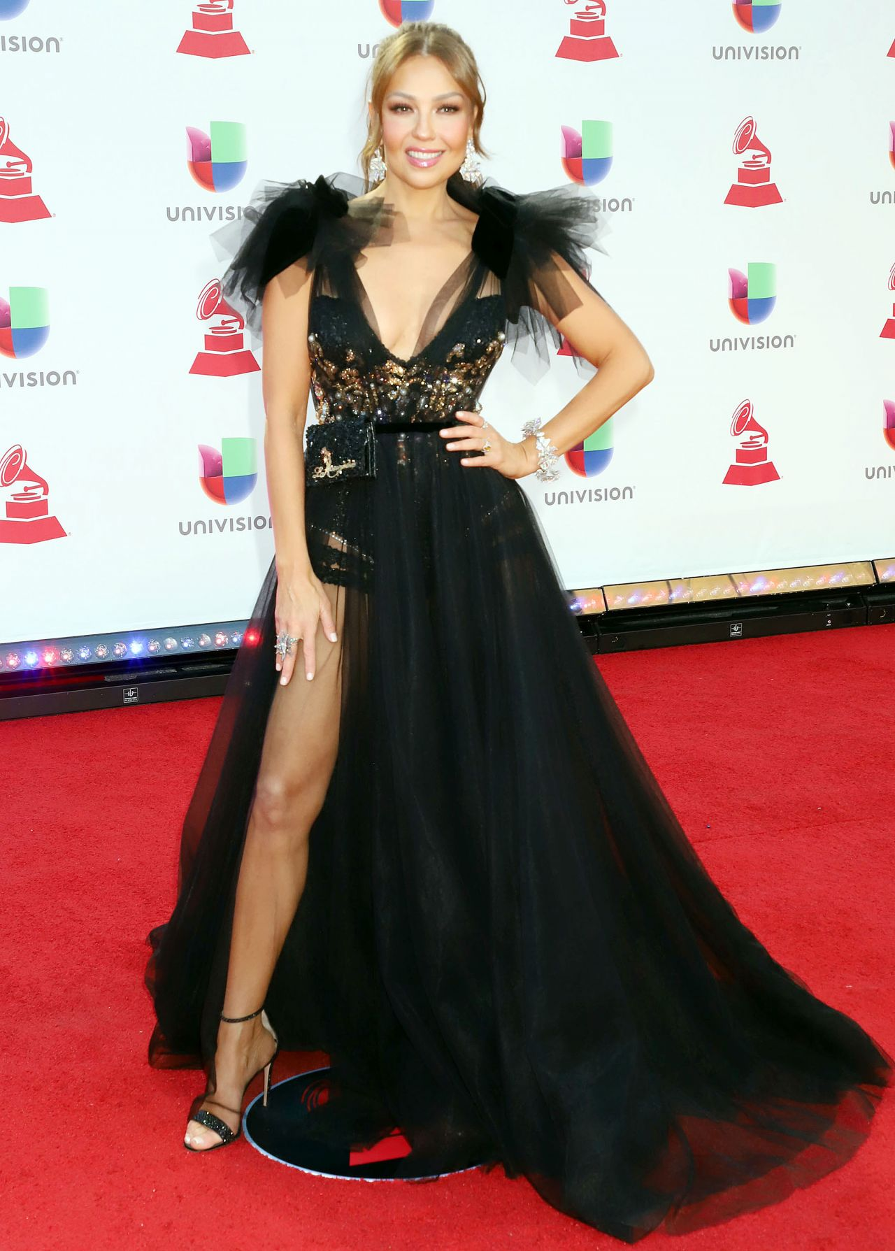 https://celebmafia.com/wp-content/uploads/2018/11/thalia-2018-latin-grammy-awards-7.jpg