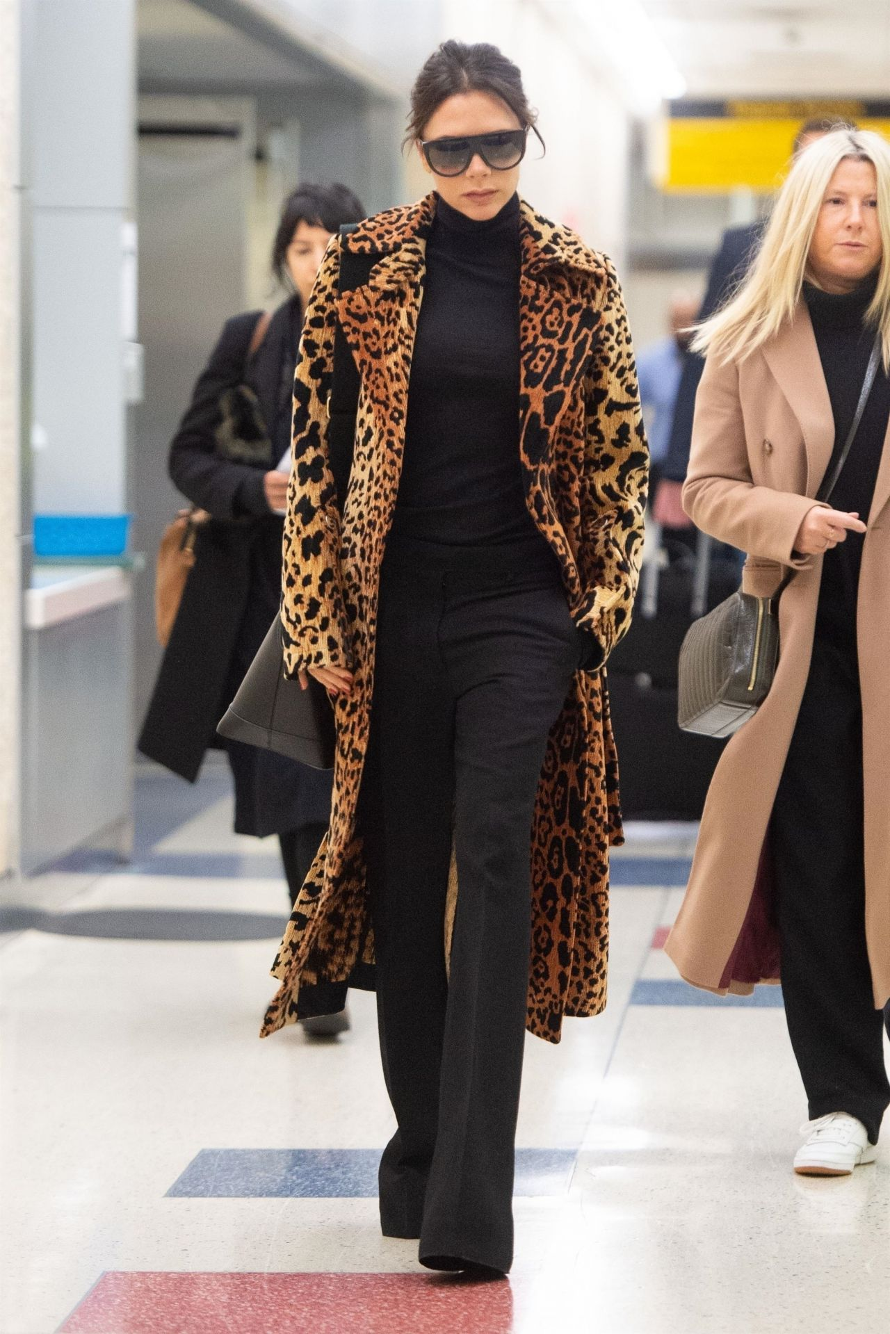 Victoria Beckham in a Faux Leopard Coat - JFK Airport in ...