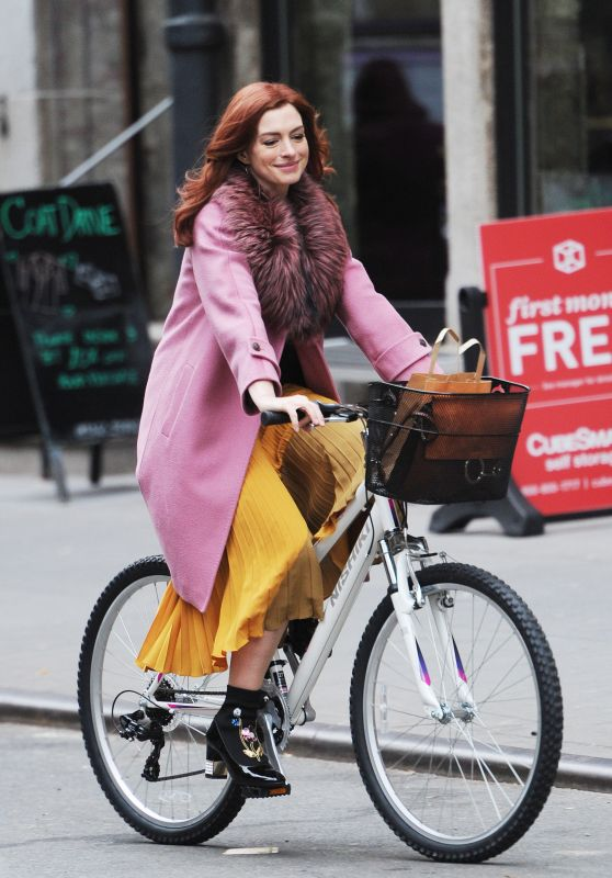 """Anne Hathaway - Rides a Bicycle on the Set of """"Modern Love"""" in NYC 11/30/2018"""