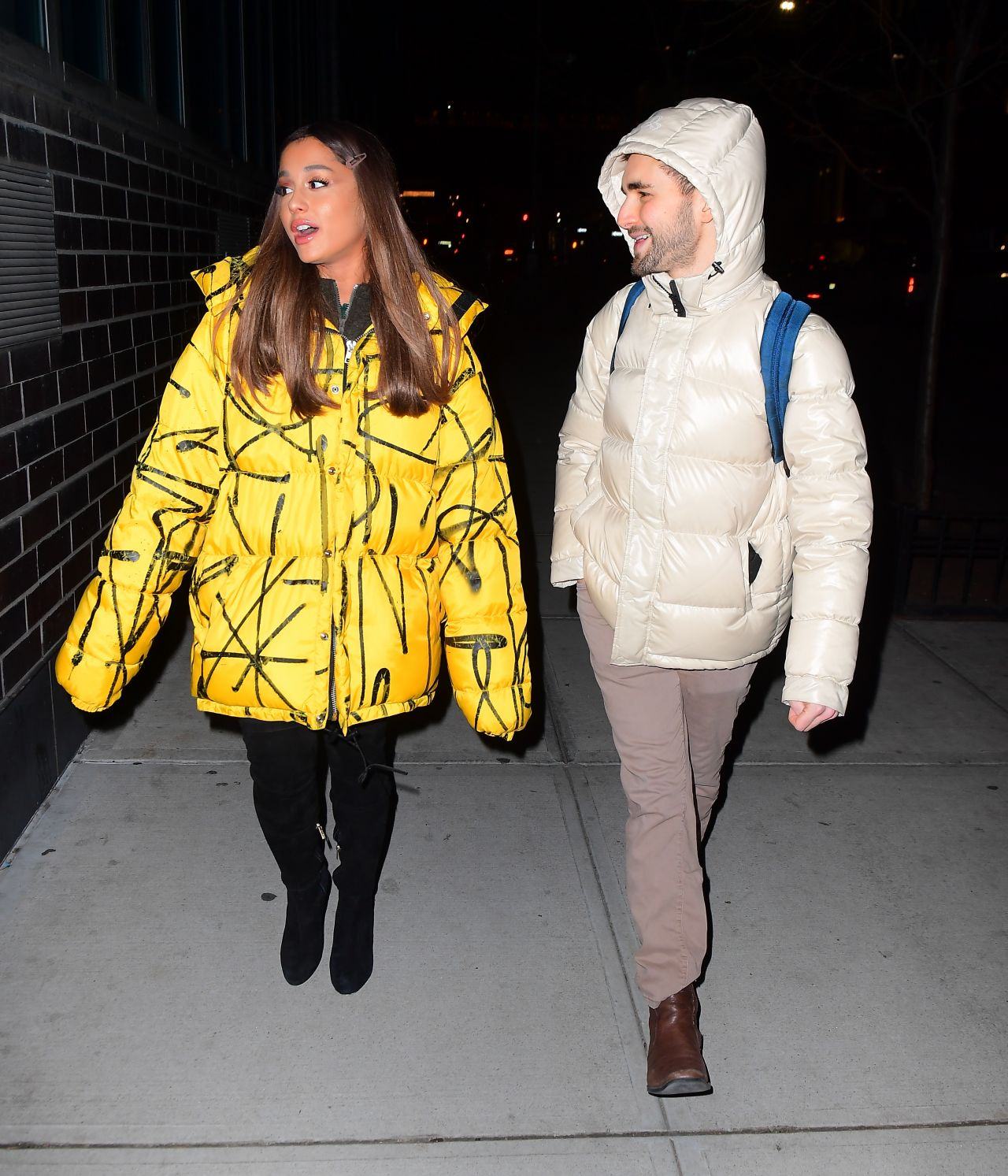 5959ef9d4 Ariana Grande in Oversized Yellow Puffer Jacket 12/11/2018