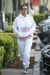 Kourtney Kardashian in Grey Sweatsuit Hoodie, Black High-Top Sneakers and Dark Sunglasses 12/02/2018