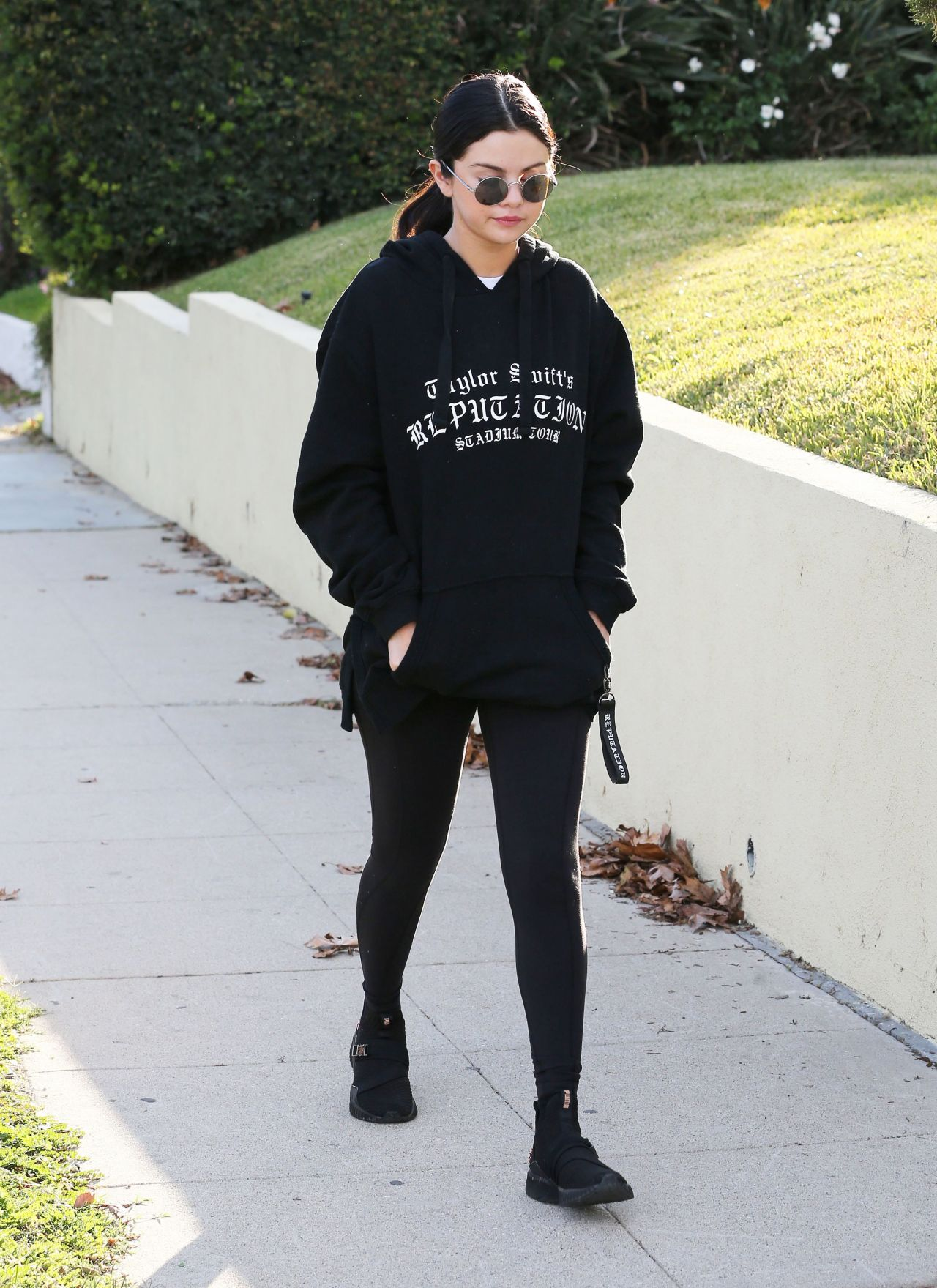 f5f3b7dd711a Selena Gomez in Taylor Swift Hoodie and Black Leggings 12 26 2018