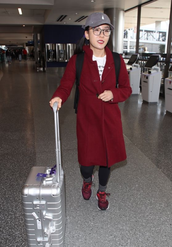 Constance Wu in a Red Coat - LAX in Los Angeles 01/09/2019