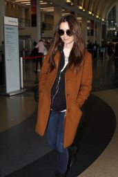 Lily Collins in Travel Outfit - LAX Airport 02/27/2019