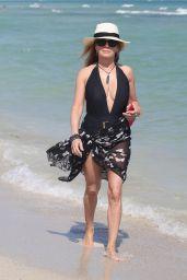Ramona Singer in a Low Cut Black Swimsuit 02/18/2019