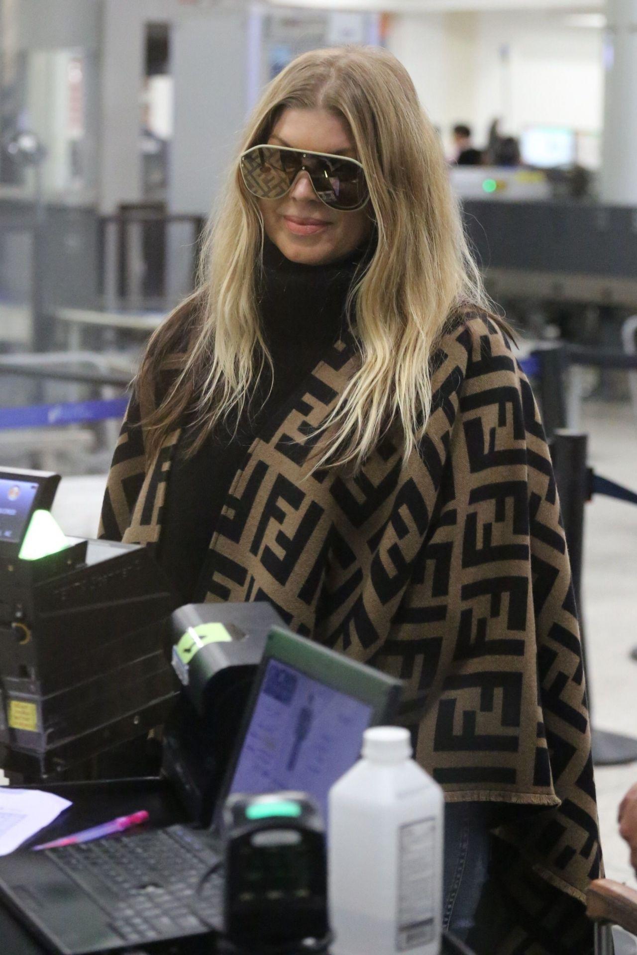 Fergie in a Fendi Poncho - LAX Airport in LA 03/19/2019
