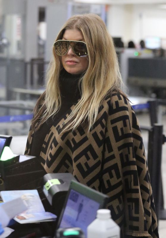 Fergie in a Fendi Poncho - LAX Airport in LA 03/19/2019