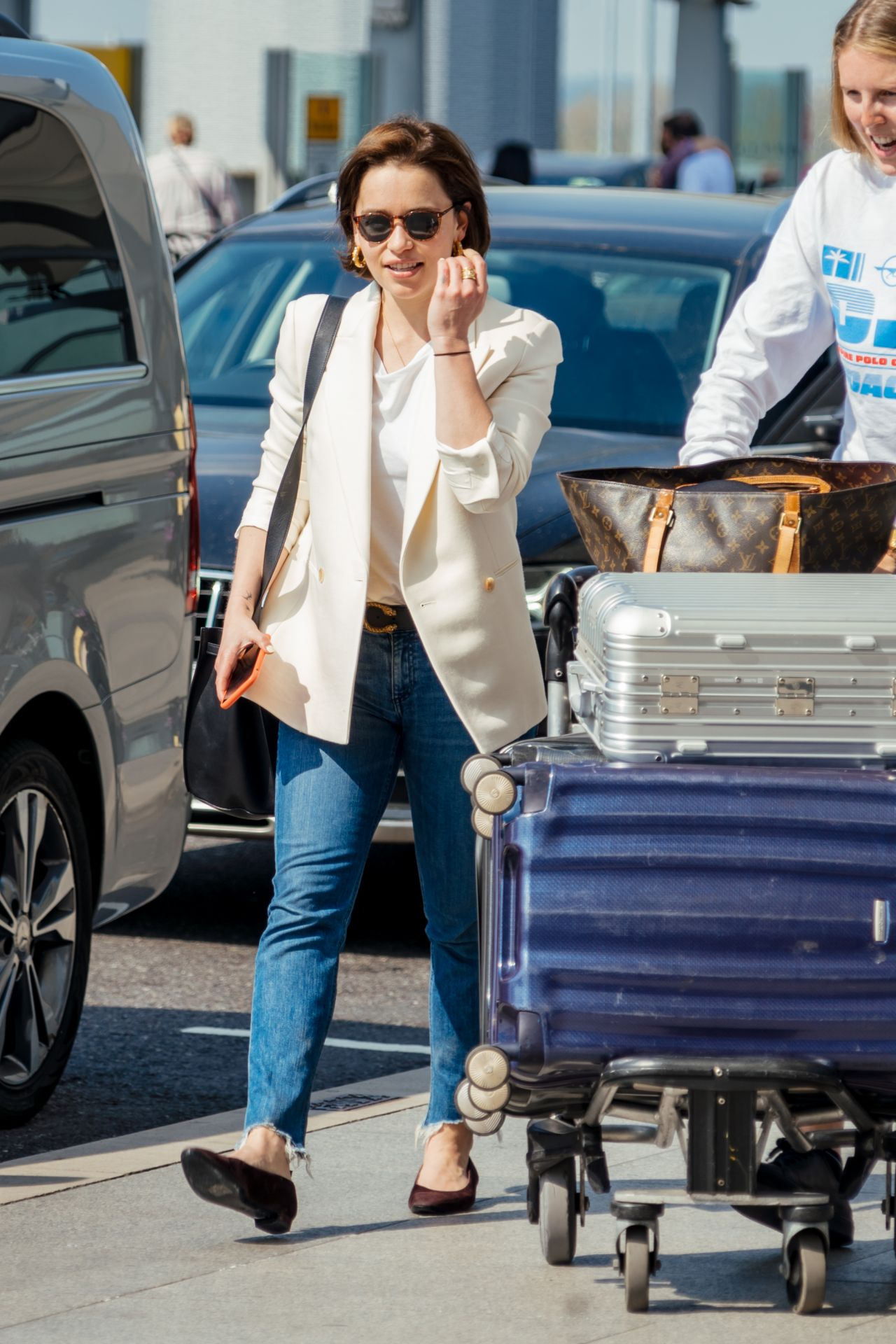 Emilia Clarke In Travel Outfit Heathrow Airport In