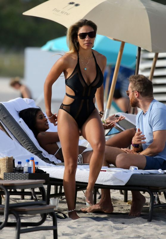 Jessica Ledon in a Black Swimsuit on the Beach in Miami 03/30/2019