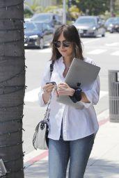 Dakota Johnson - Holds on to Her Mac Book in Beverly Hills 05/29/2019