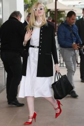 Elle Fanning Shows Off Her Eclectic Style - Martinez Hotel in Cannes 05/20/2019