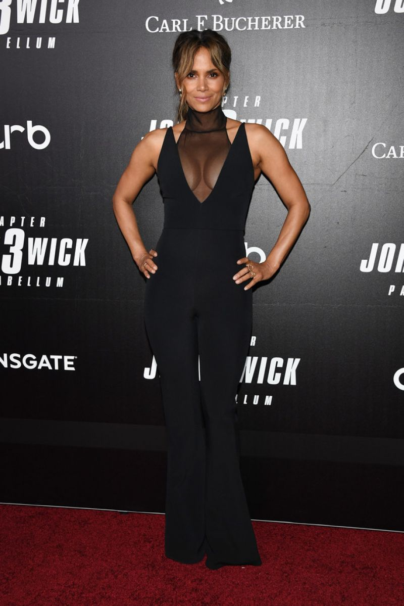Halle Berry gorgeous in black showing off nice boobs and cleavage at John Wick movie premiere