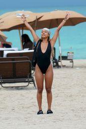 Karrueche Tran in a Black Swimsuit at the Beach in Miami Beach 05/13/2019