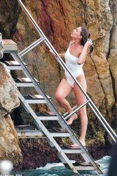 Margot Robbie in Swimsuit at Eden Roc Hotel in Cannes 05/21/2019