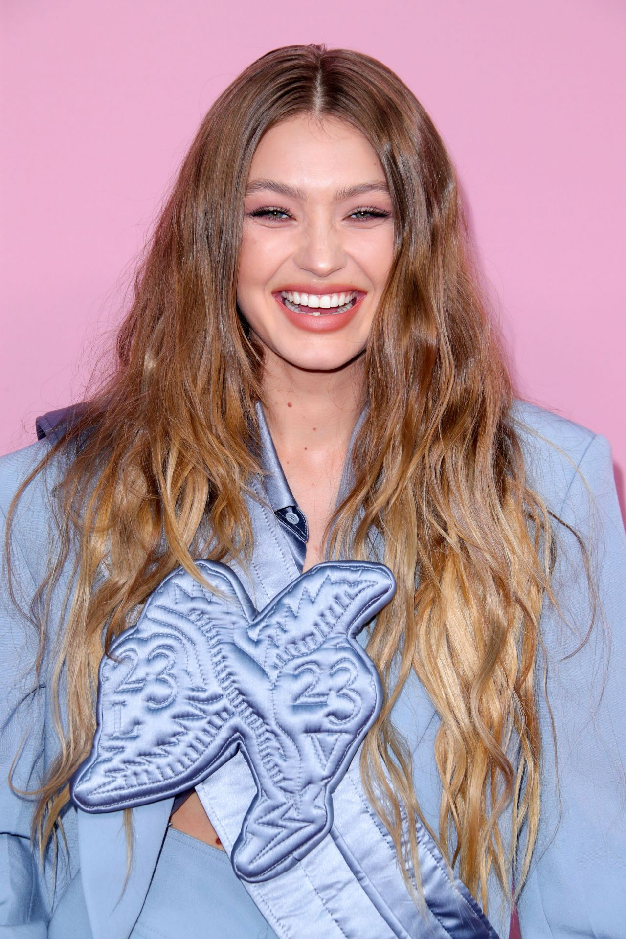hadid gigi awards cfda nyc bella hair blonde braless dark long mane attraction york