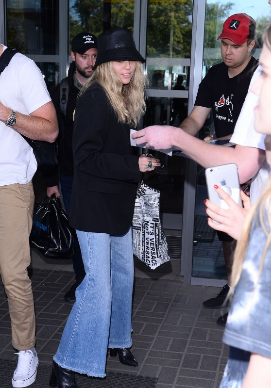 Miley Cyrus in Travel Outfit at the Airport in Warsaw 06/01/2019