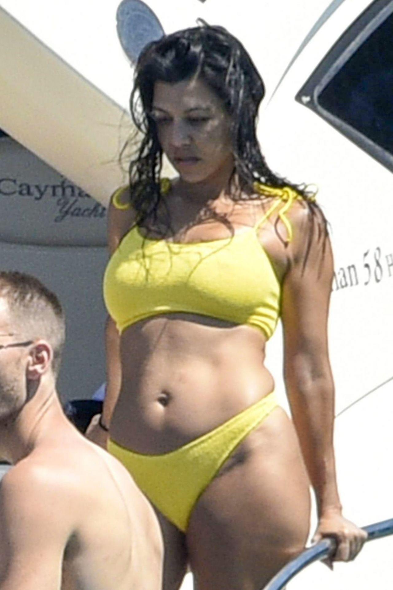 Kourtney Kardashian in a Yellow Bikini on a Yacht in ...