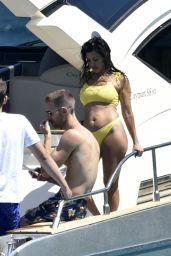 Kourtney Kardashian in a Yellow Bikini on a Yacht in Corsica 07/26/2019