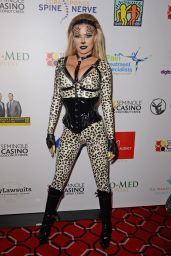 Carmen Electra in Skintight Catsuit and Dramatic Animal Print 10/17/2019
