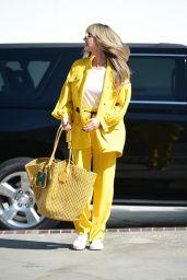 Heidi Klum in a Yellow Jacket and Elastic-Waist Pants 10/18/2019