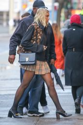 Dua Lipa in a Burberry Mini Skirt and Versace Shoes 01/16/2020