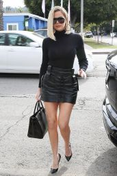 Khloe KardashianSshows Off Her Legs in Black Minidress 01/03/2020