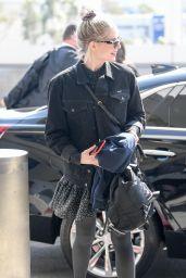 Lucy Boynton in a Black Denim Jacket and Floral Mini-Dress 02/16/2020