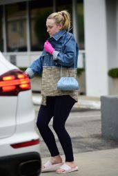 Dakota Fanning Wears Pink Latex Gloves Amid Coronavirus Outbreak in LA 03/16/2020