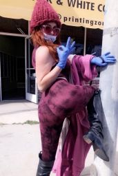 Phoebe Price in a Purple Ensemble With a Surgical Mask and Gloves 03/24/2020
