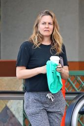 Alicia Silverstone in a Simple Black T-Shirt and Charcoal Grey Drawstring Sweatpants