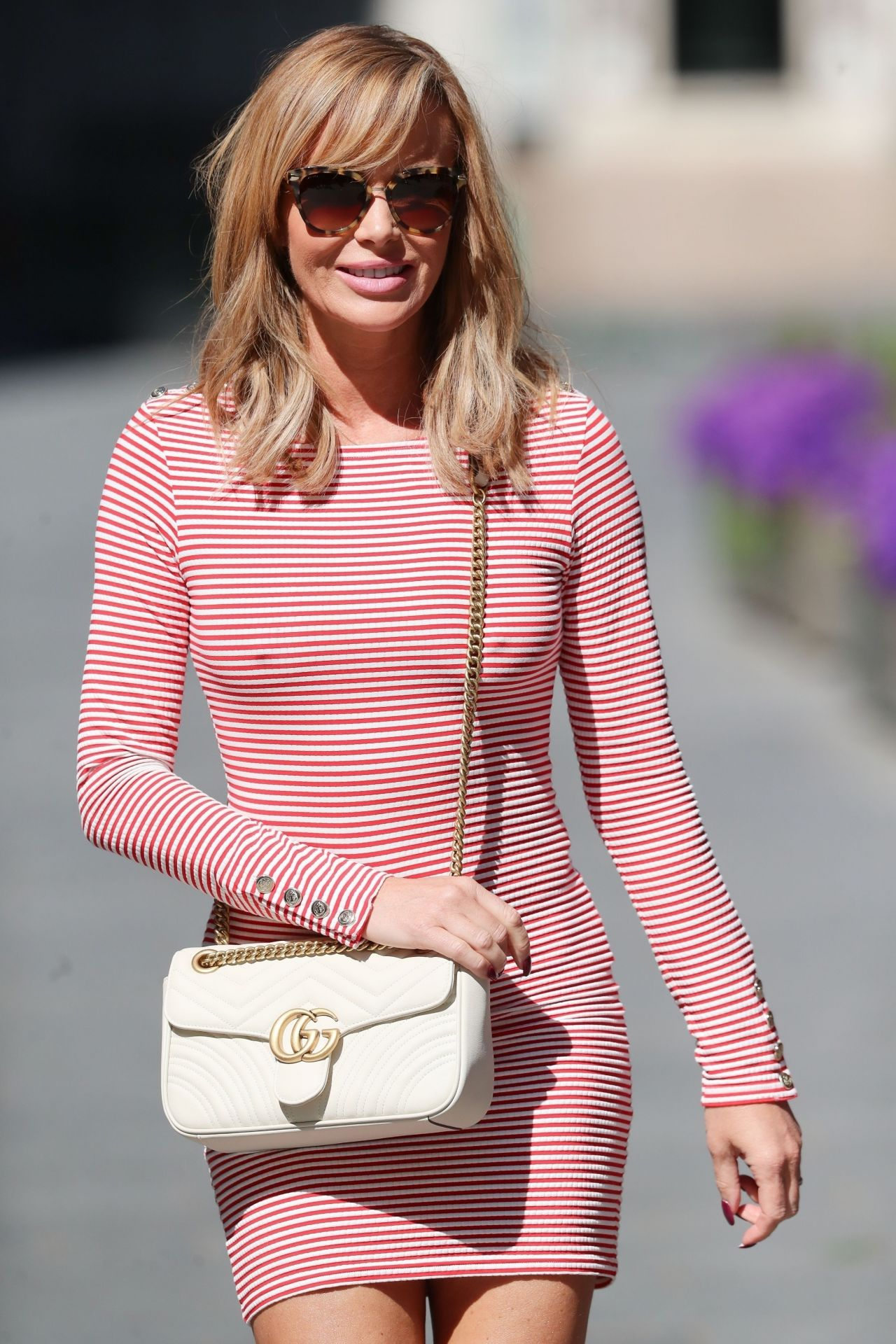 Amanda Holden Shows Off Her Legs In A Tight Red And White
