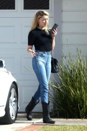 Amber Heard in Dark-Wash Jeans and Black Cowboy Boots 05/19/2020