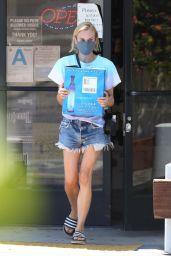 Diane Kruger Wearing a Tie-Dye Shirt Over Frayed Denim Shorts