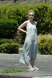 Elle Fanning in a Long Sleeveless Floral Print Dressout - LA 05/12/2020