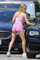 Hailey Bieber in a Pink Crop Top With Tiny Shorts