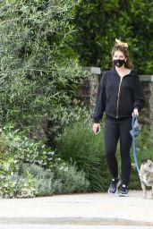 Katherine Schwarzenegger in Black Zip-Up Hoodie, Fitted Leggings and a Matching Pair of Sneakers