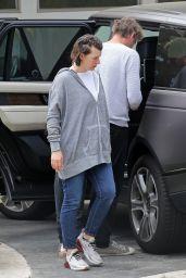 Milla Jovovich - Arriving at a Friend